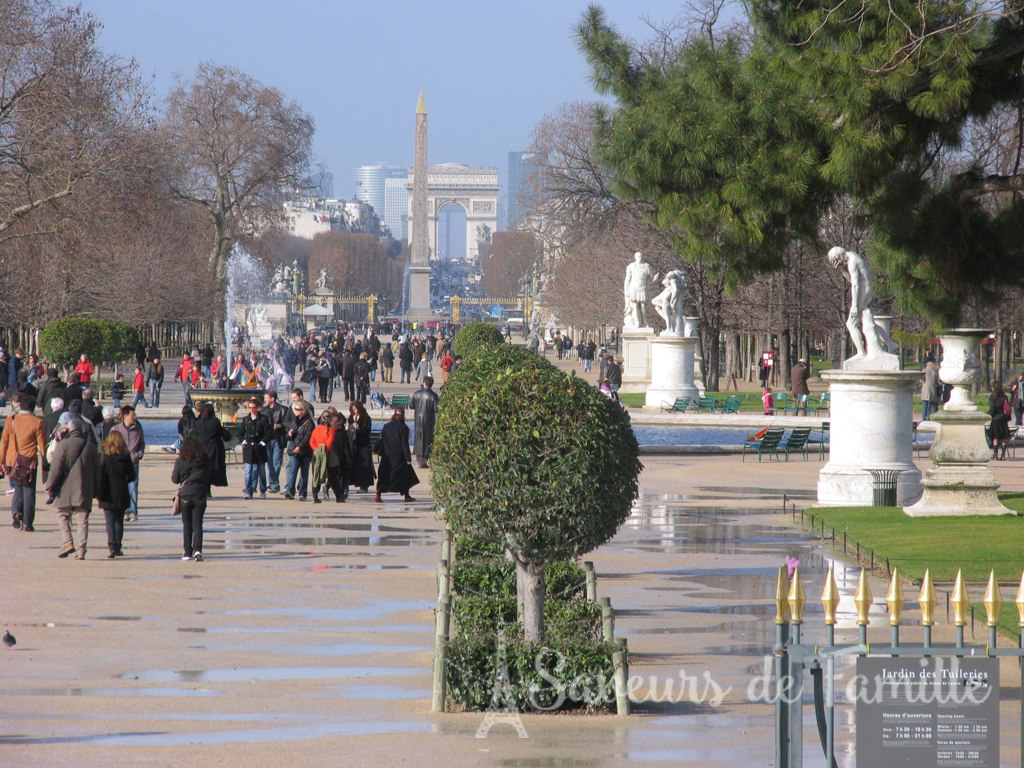 Picture taken from the Jardins des Tuileries of the Obelisk in Place de la Concorde aligned with the Arc de Triomphe seen in the distance