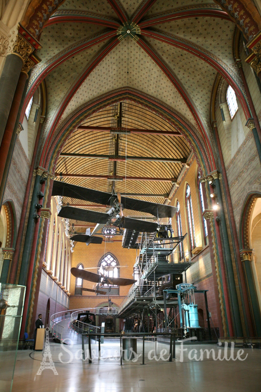 An airplane on exhibit in the chapel of the Musée des Arts et Métiers